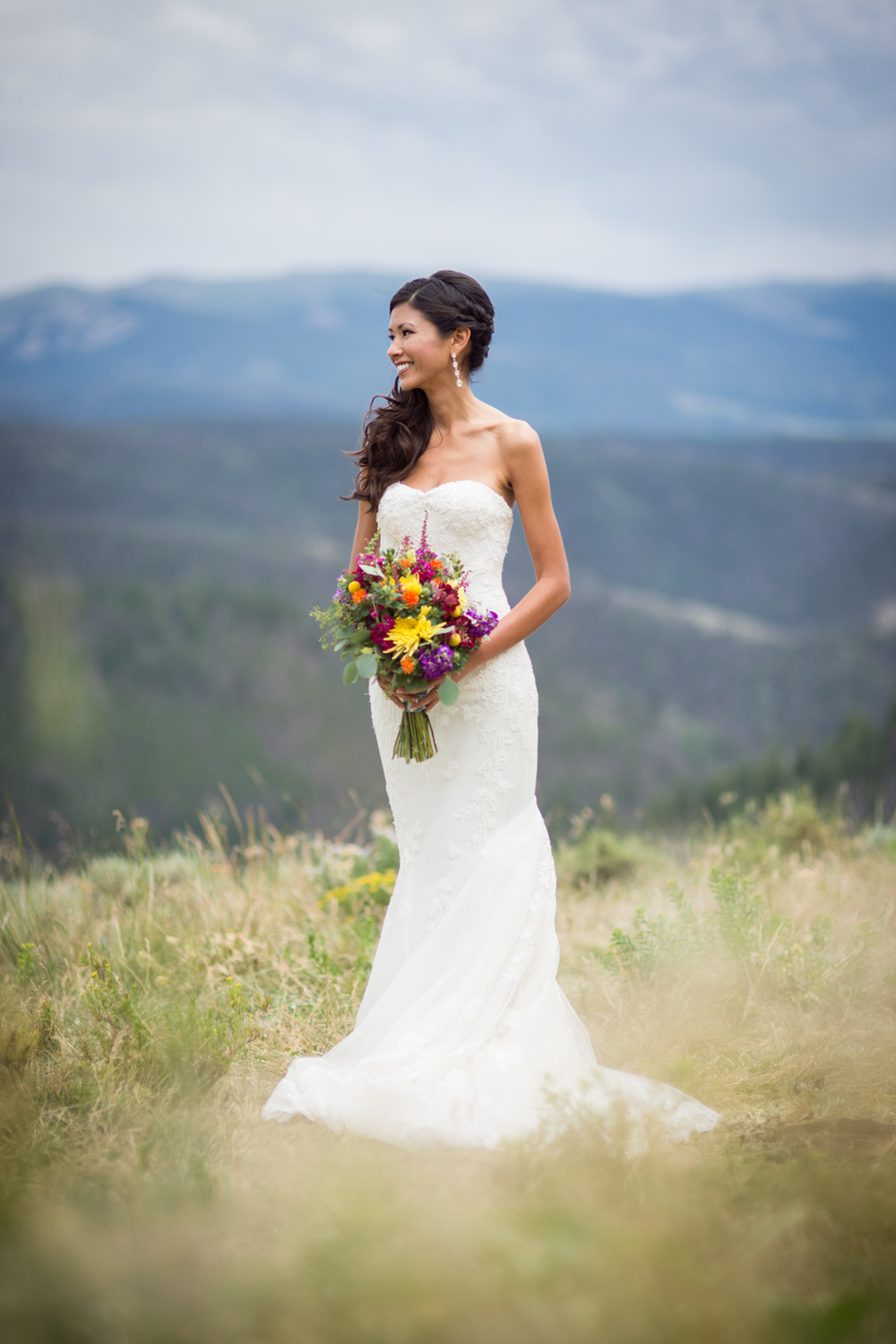 gorgeous bride on mountain top in Colorado