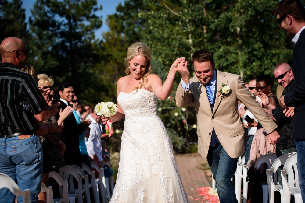 bride and groom dance down the aisle after ceremony