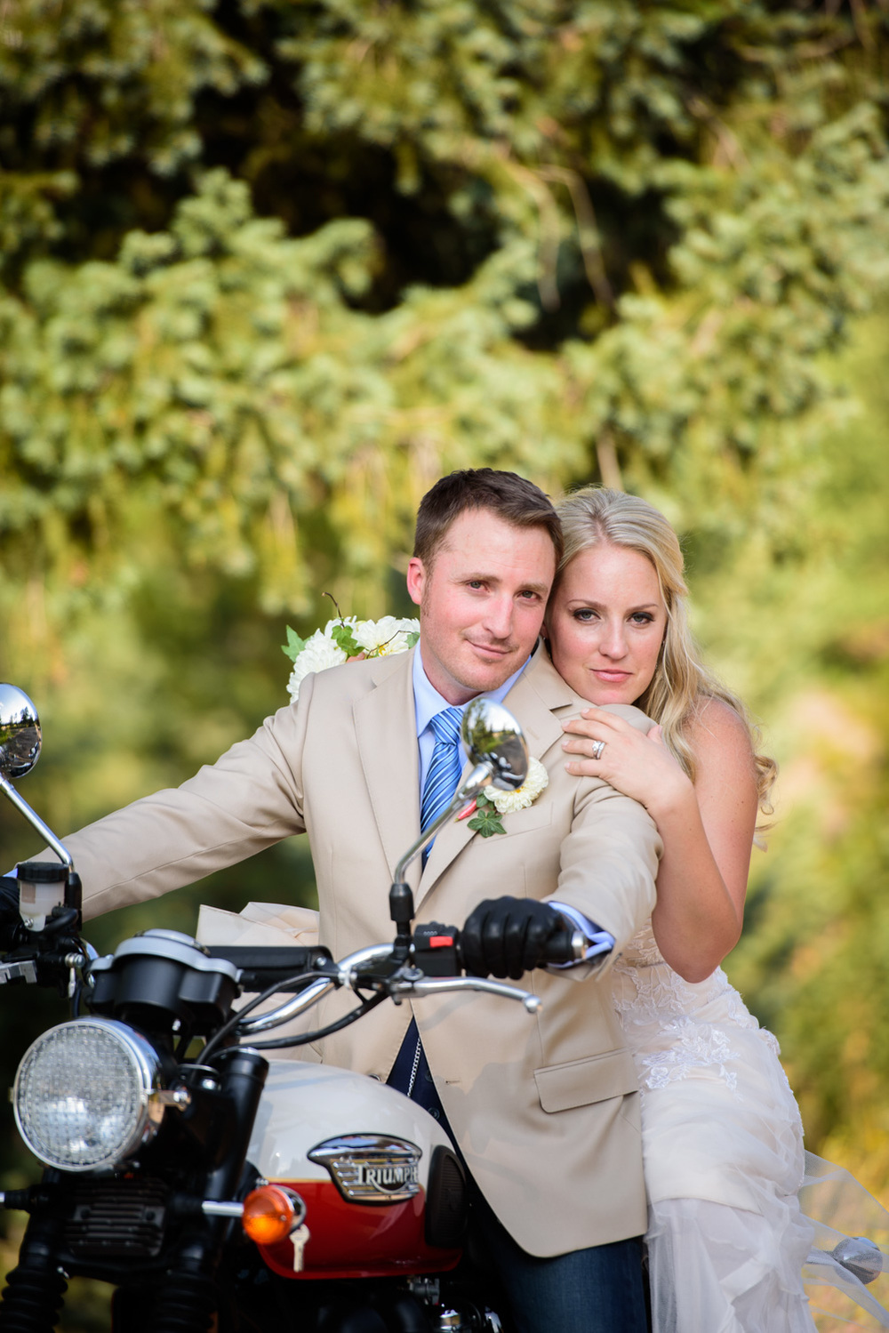 Bride and Groom pose on Motorcycle in Evergreen