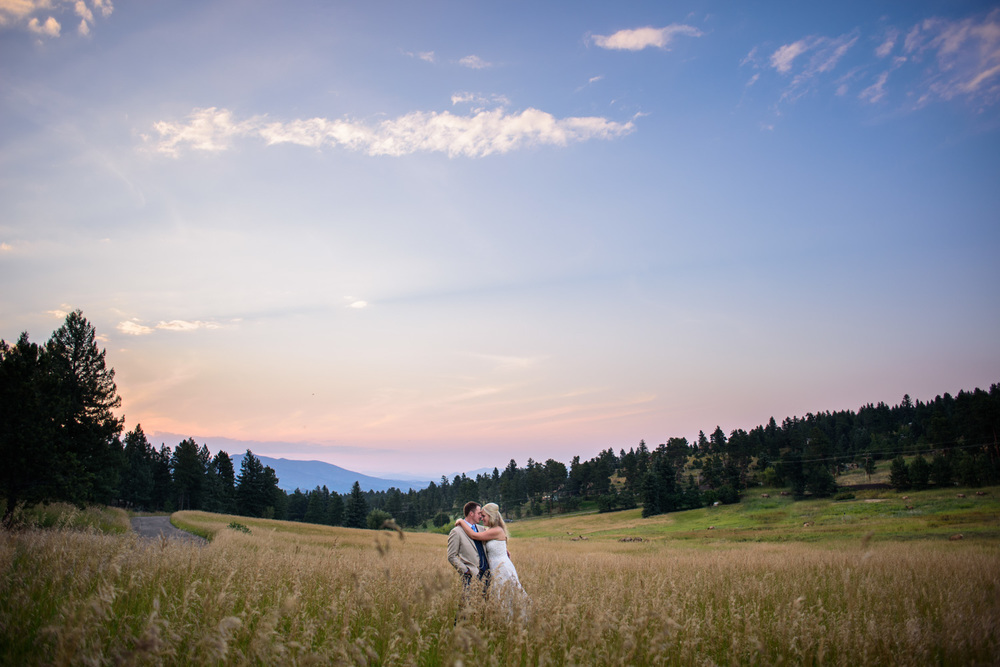 Bride and Groom in front of sunset in Evergreen