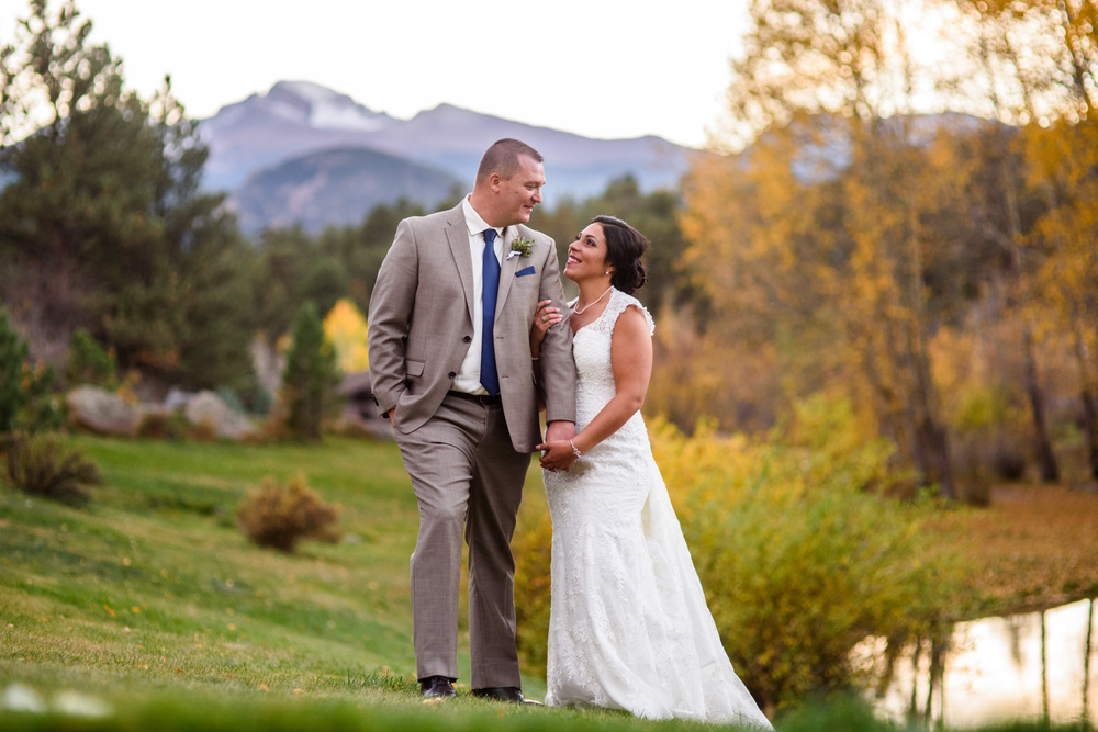 wedding couple pose in front of Longs Peak in fall