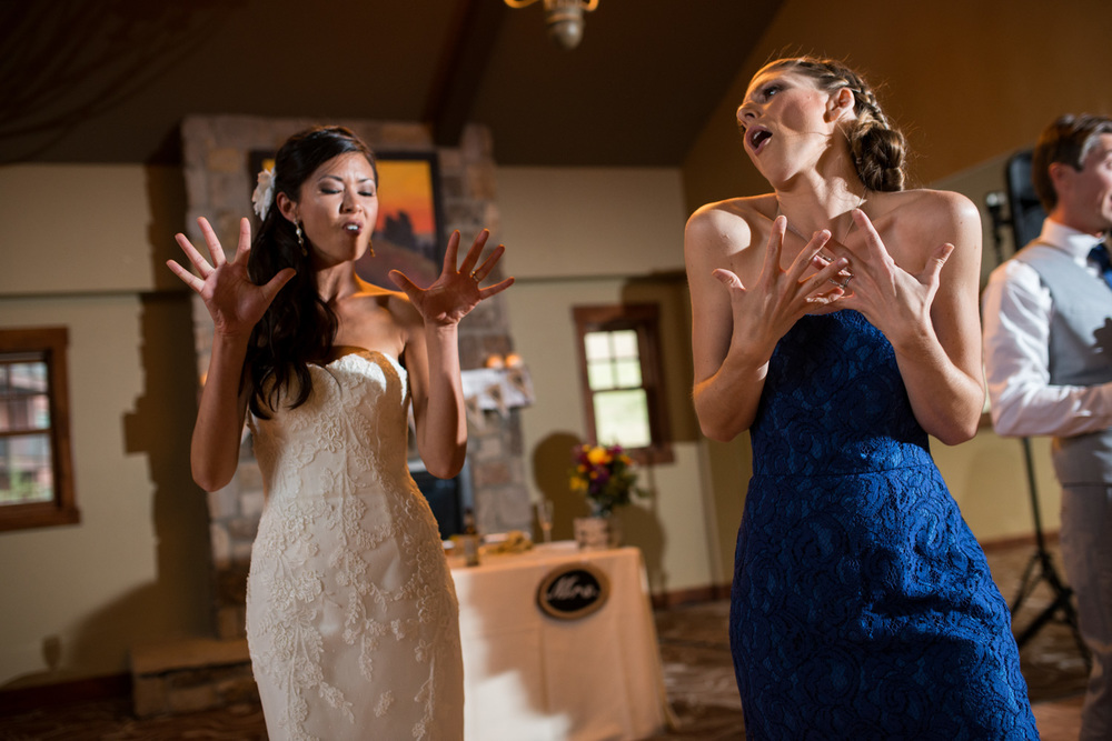 Bride dances with Maid of honor at wedding reception