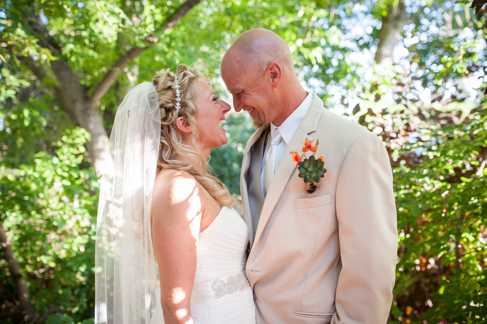 laughing bride and groom at morningside manor colorado
