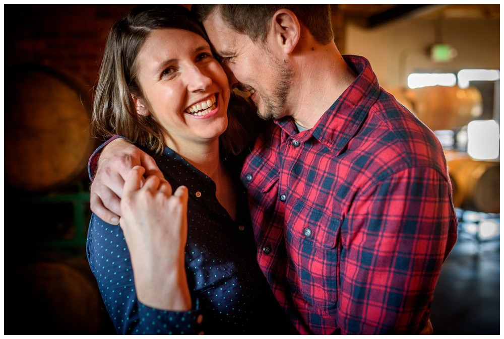laughing couple hug in Denver Brewery