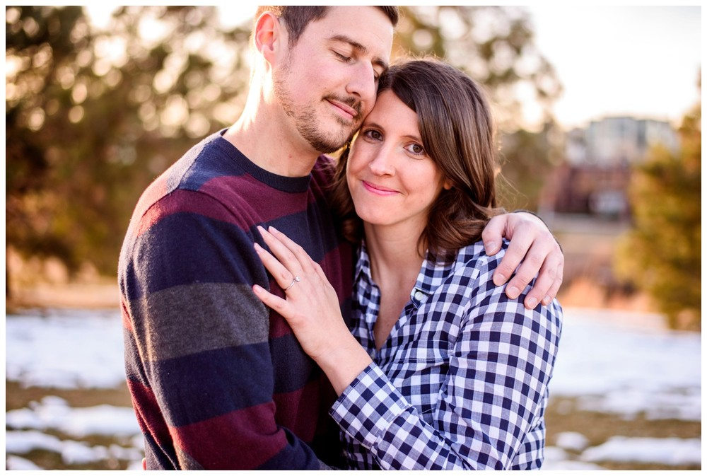 couple hug during winter engagement photography session