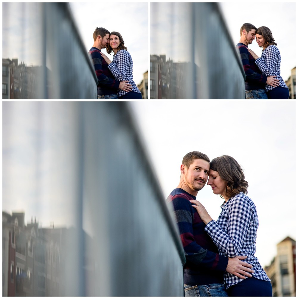 couple pose on bridge at sunset in Denver