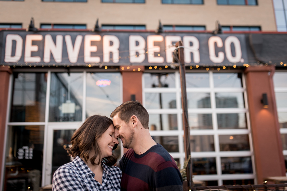 engagement photo in front of Denver Beer Company brewery