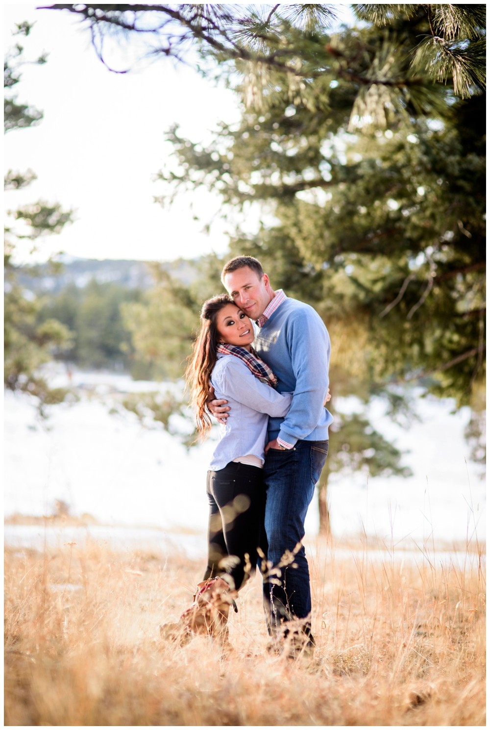 engagement photo in sunny Colorado Pine trees