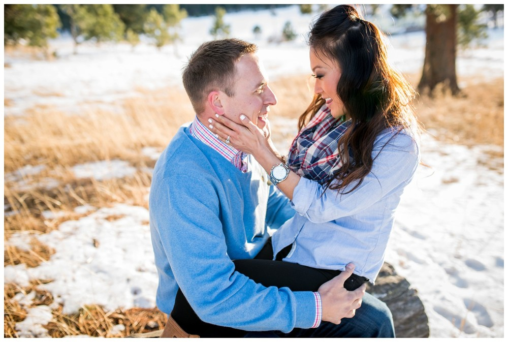 candid engagement photo of couple laughing in Colorado mountains