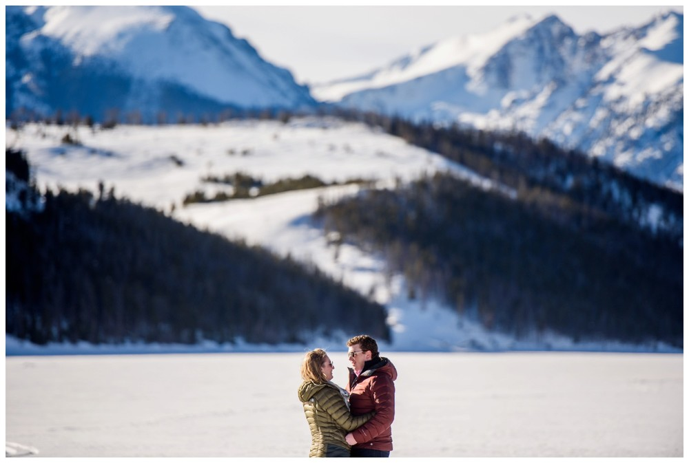 winter engagement photo of couple on Lake Dillon near Frisco colorado