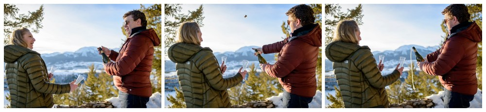 couple opens champagne bottle in mountains
