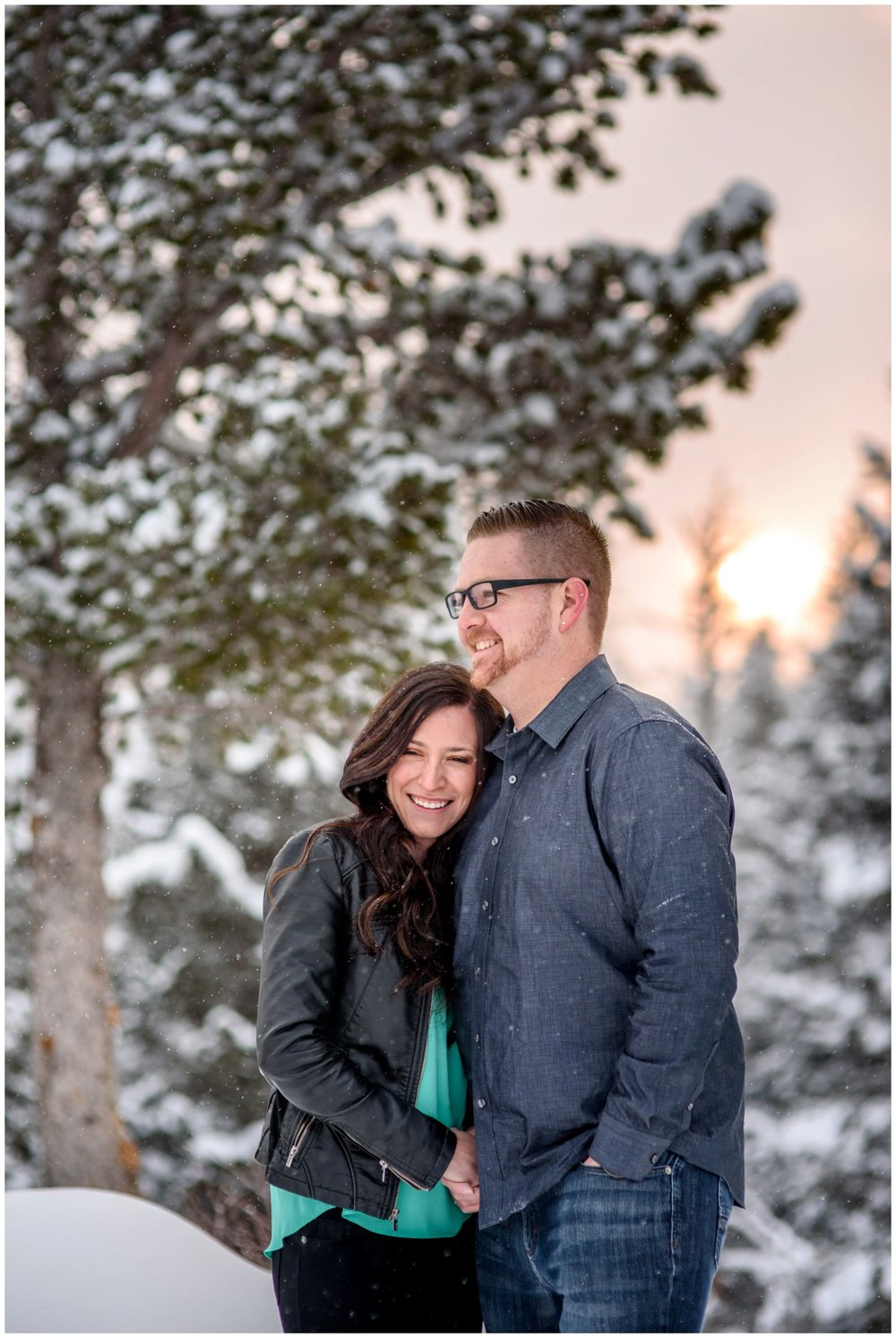 couple laughs on colorado mountain at sunrise