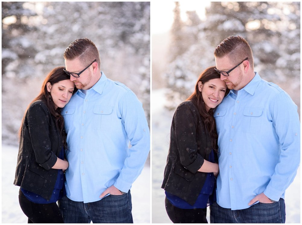 couple hugs during snowy mountain engagement photo