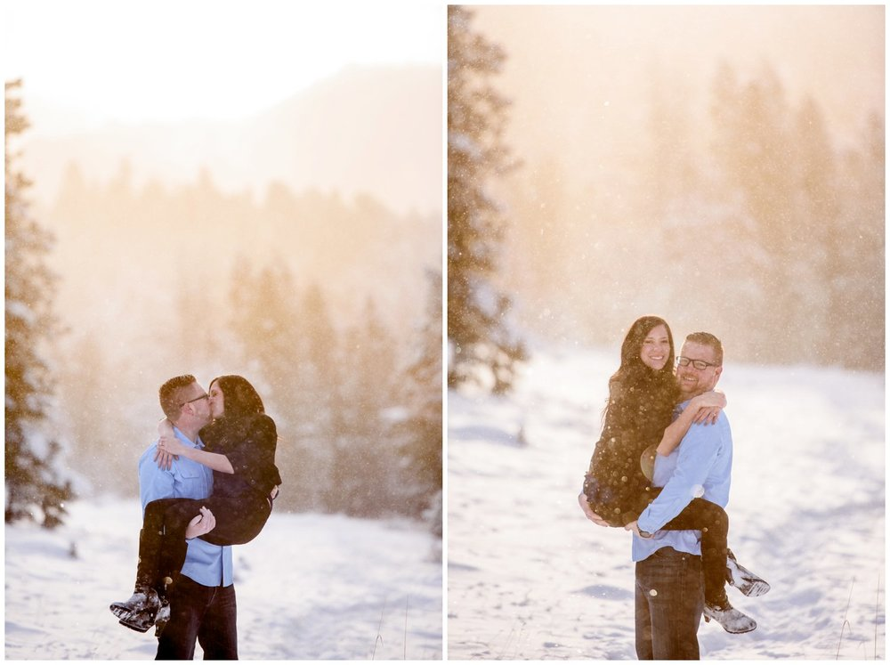 guy lifts up girl in national park engagement session