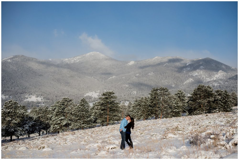 engagement photo in colorado winter mountain meadow