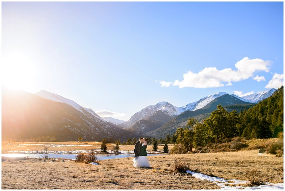 bride and groom kiss in rocky mountain national park