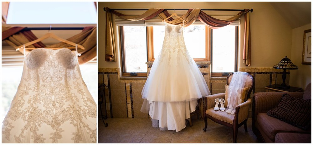 pretty wedding dress hanging in window