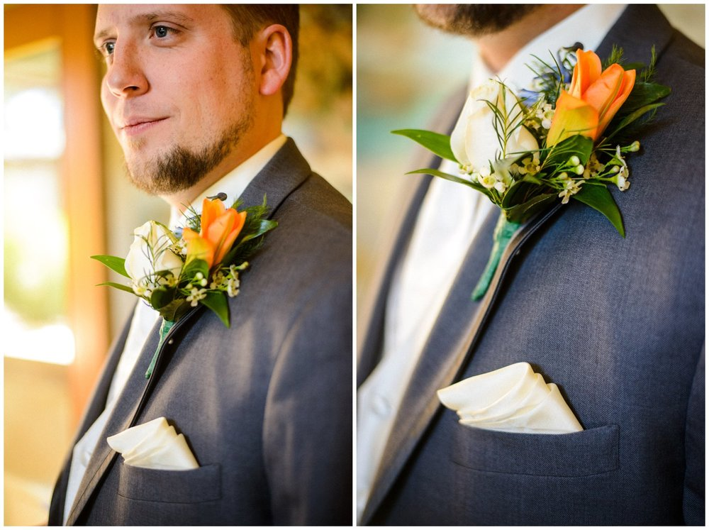 Orange Boutonniere on groom gray suit