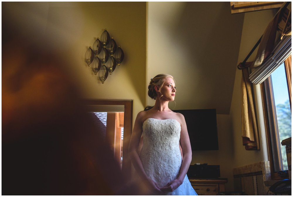 colorado bride looks out window