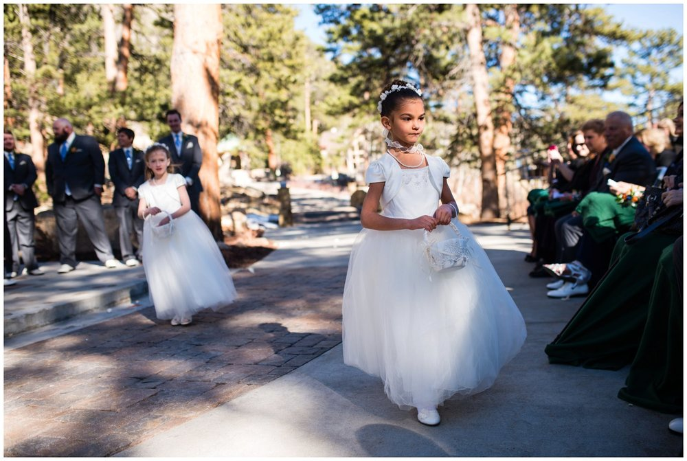 cute flower girls walk into ceremony in Colorado