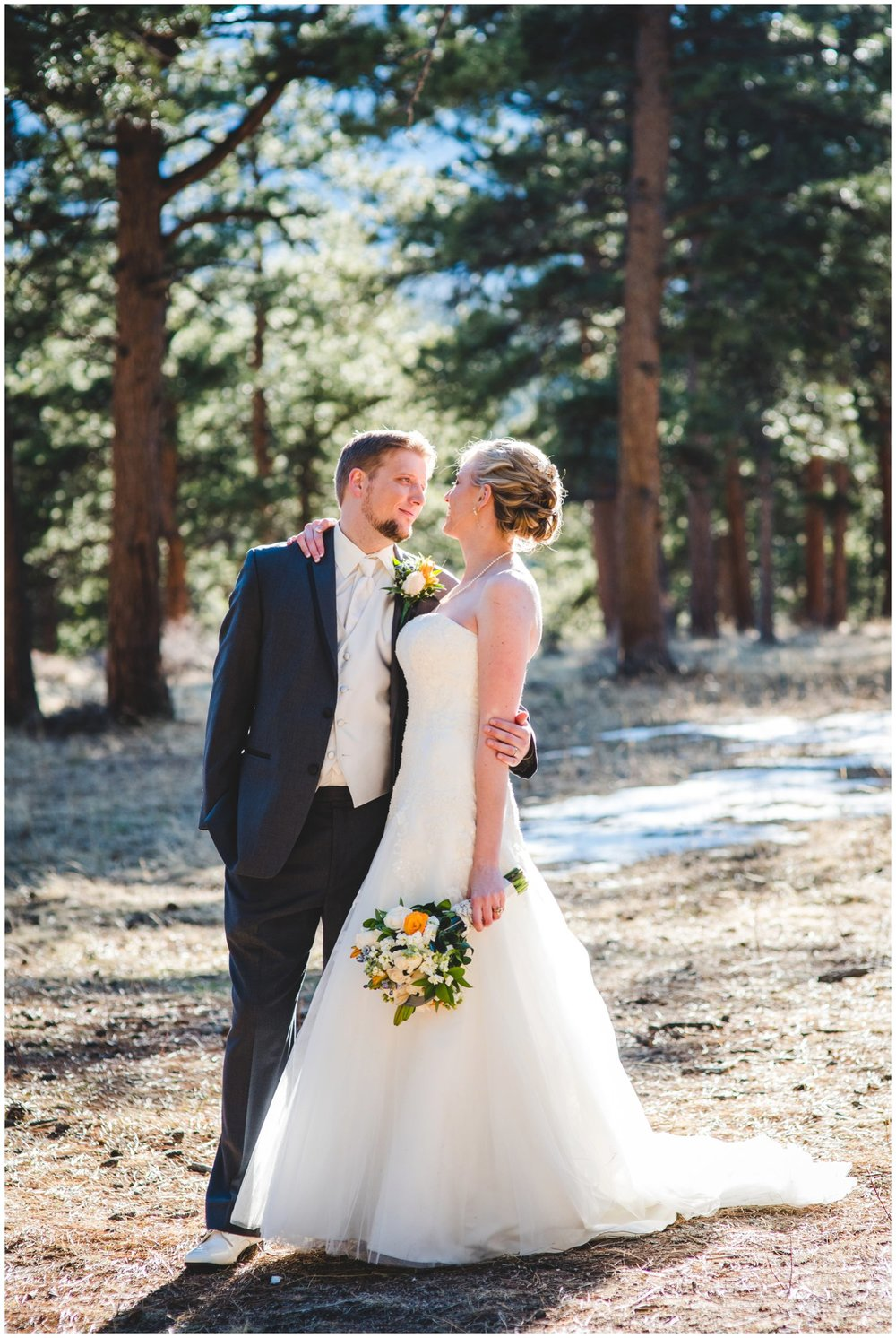 beautiful back lit bride and groom portrait in Colorado mountains