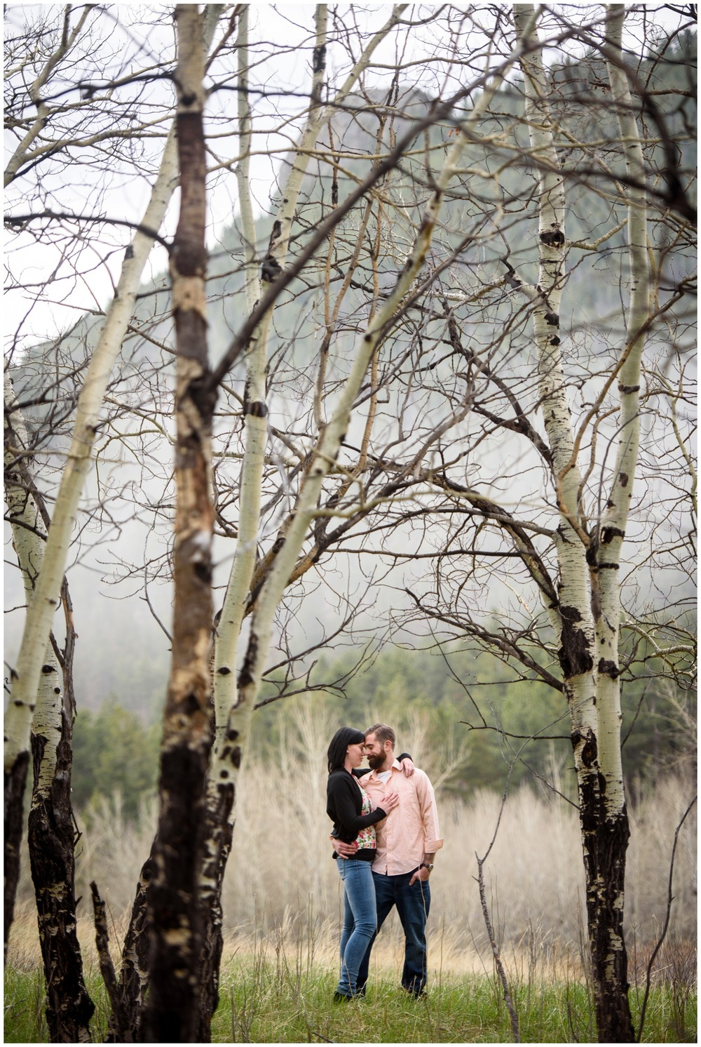 couple hugs in Aspen tree meadow in Colorado
