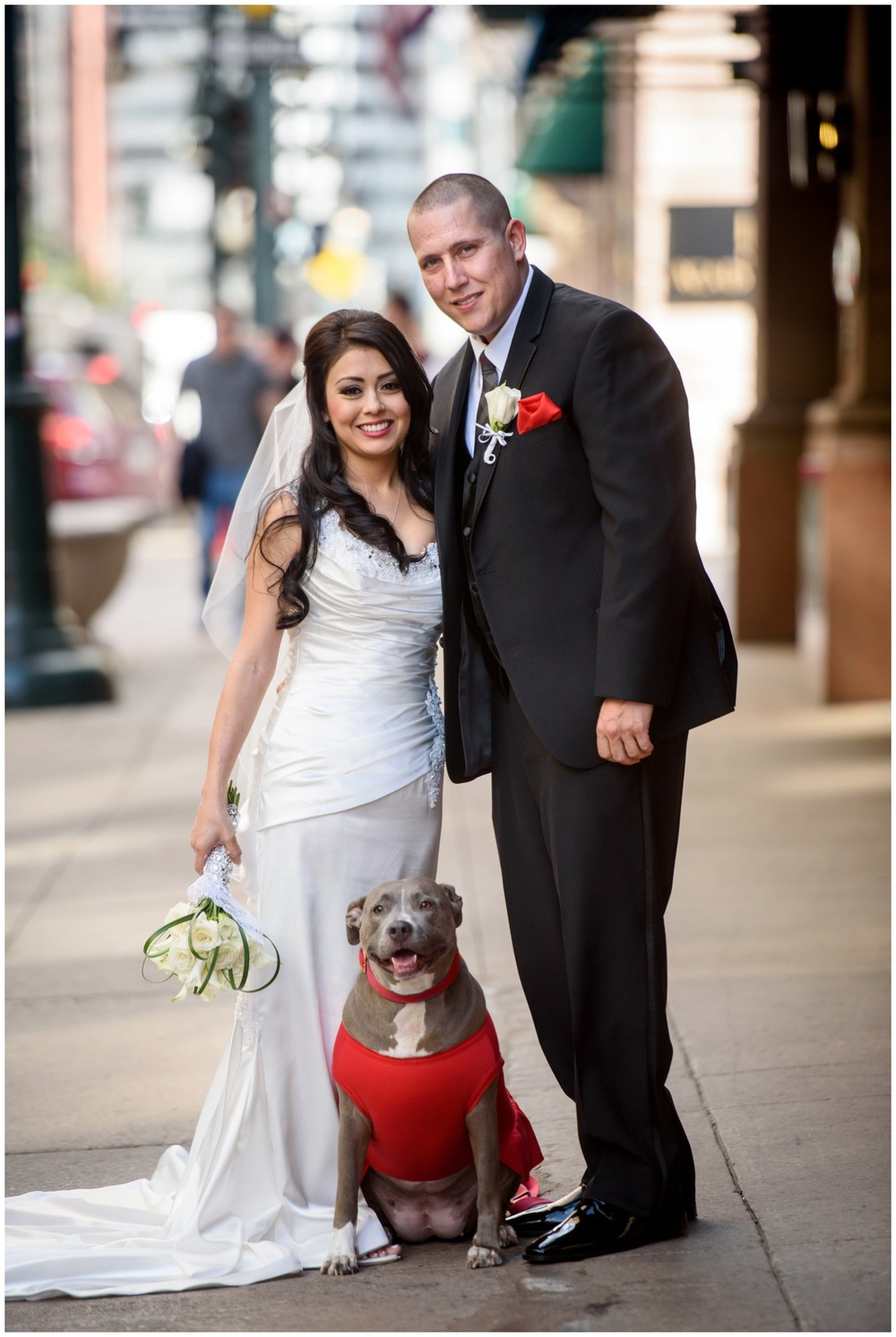 bride and groom with dog in downtown denver