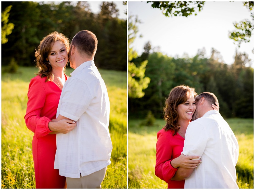 couple kisses in wildflower field engagement photo