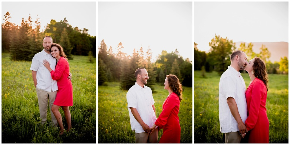 engaged couple laughs in colorado mountain meadow at sunset