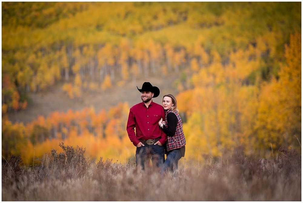 Fall mountain Engagement photo with colorful Aspen trees