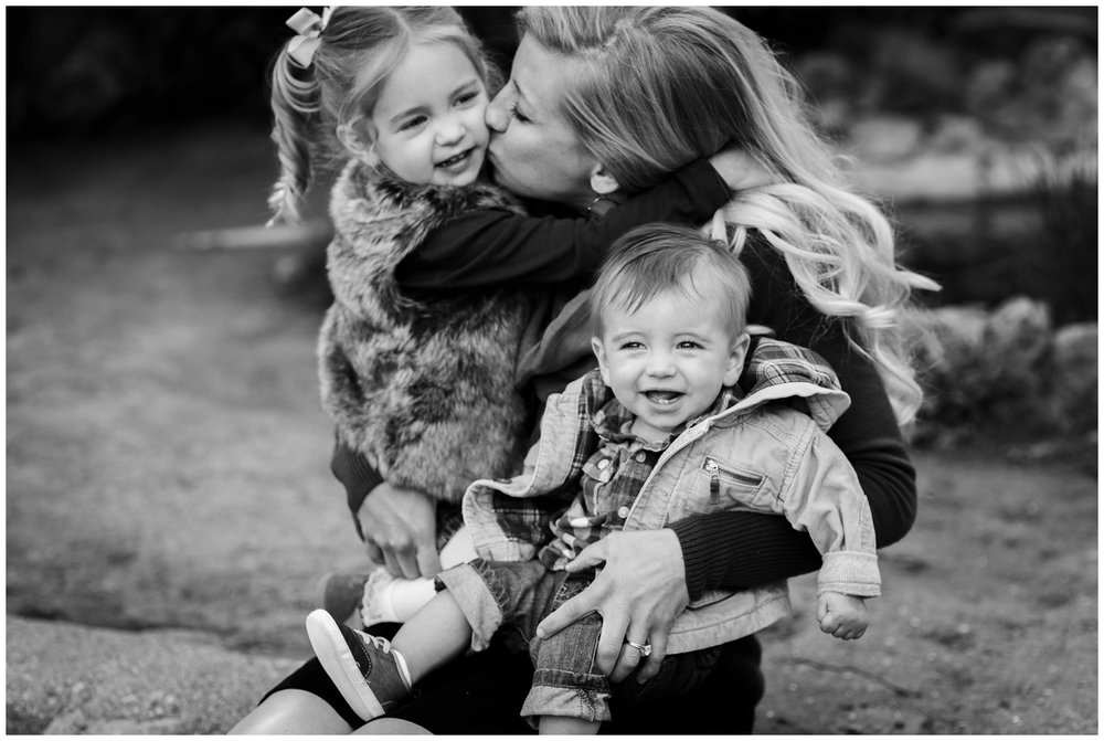 mom kisses kids in Colorado portrait