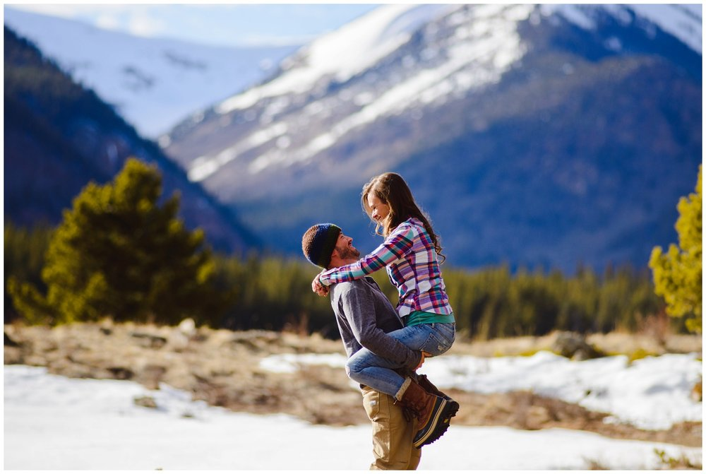 playful couple colorado mountain engagement photo
