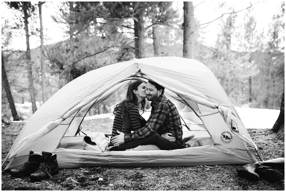 camping engagement photo of couple in tent