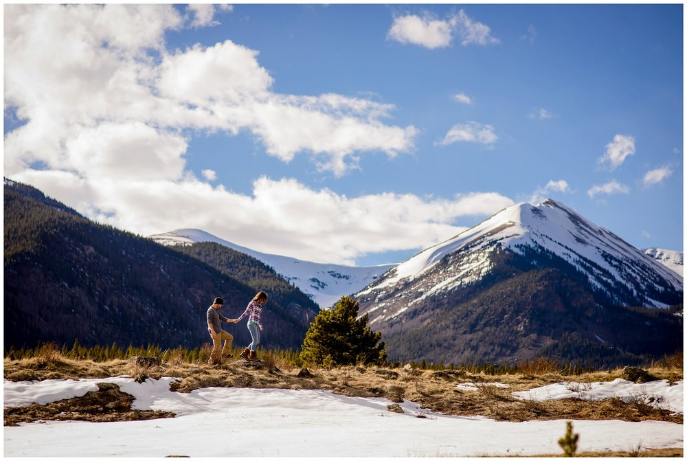 couple walks on mountain ridge near Guanella Pass