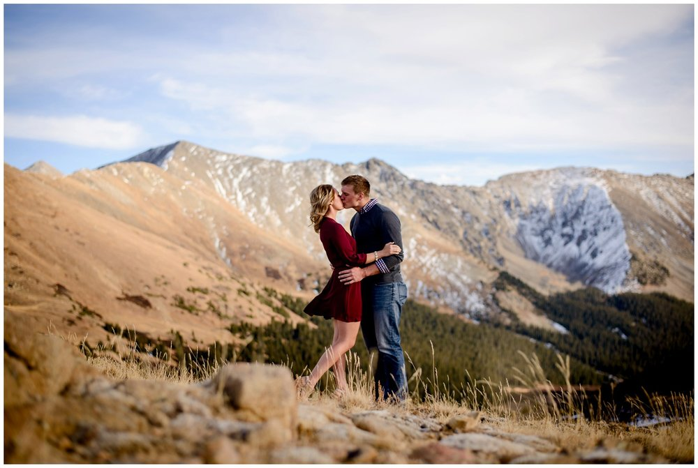engaged couple kiss on Loveland Pass mountain