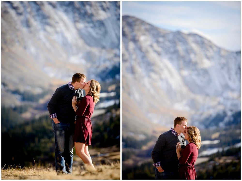 couple kisses on top of Loveland Pass