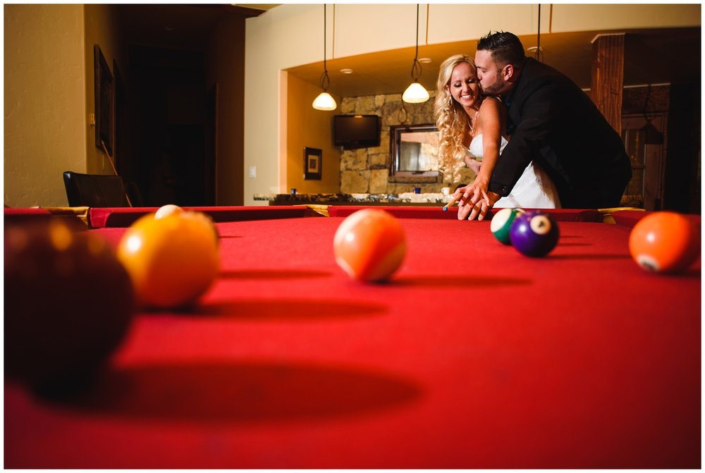 bride and groom portrait playing Pool