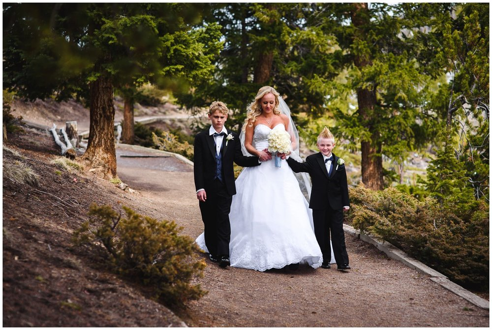 bride walks down aisle with sons