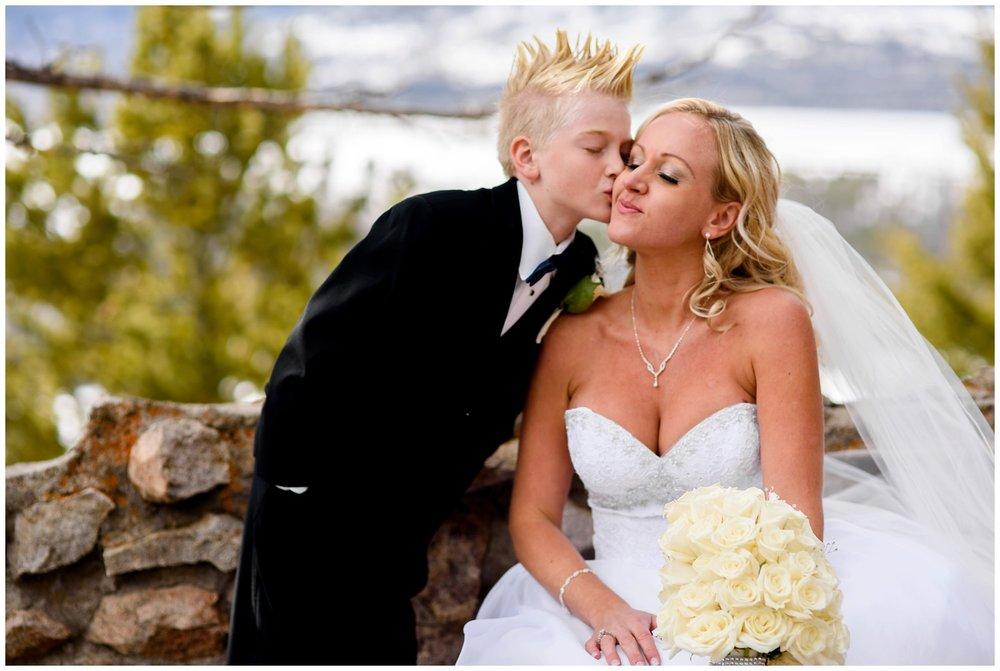 little boy kisses mom on wedding day