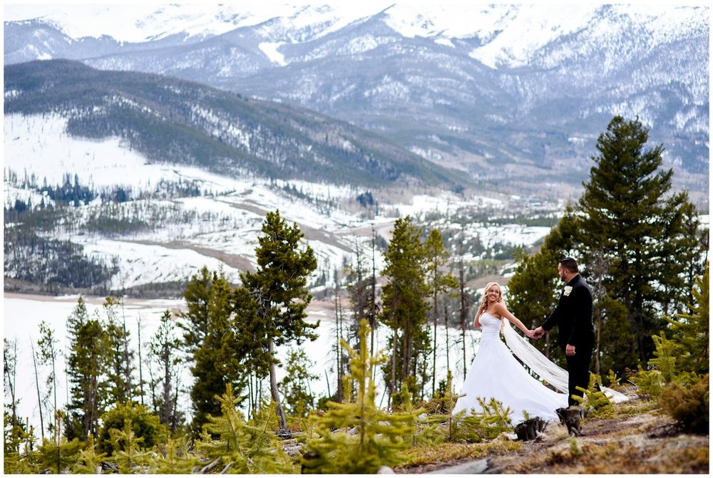 Bride and groom walk on mountain in Colorado