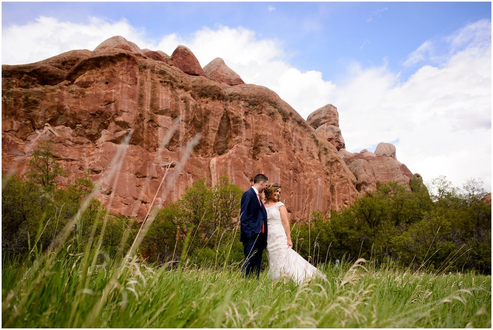 bride and groom in field at Roxborough