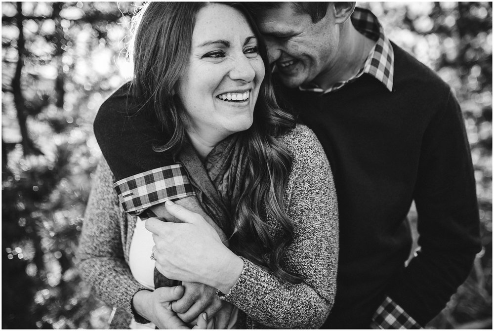 candid Colorado mountain engagement photograph