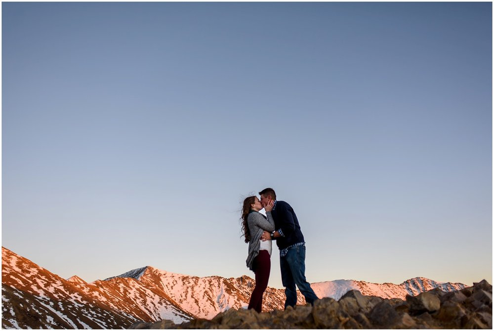 top of mountain engagement photo