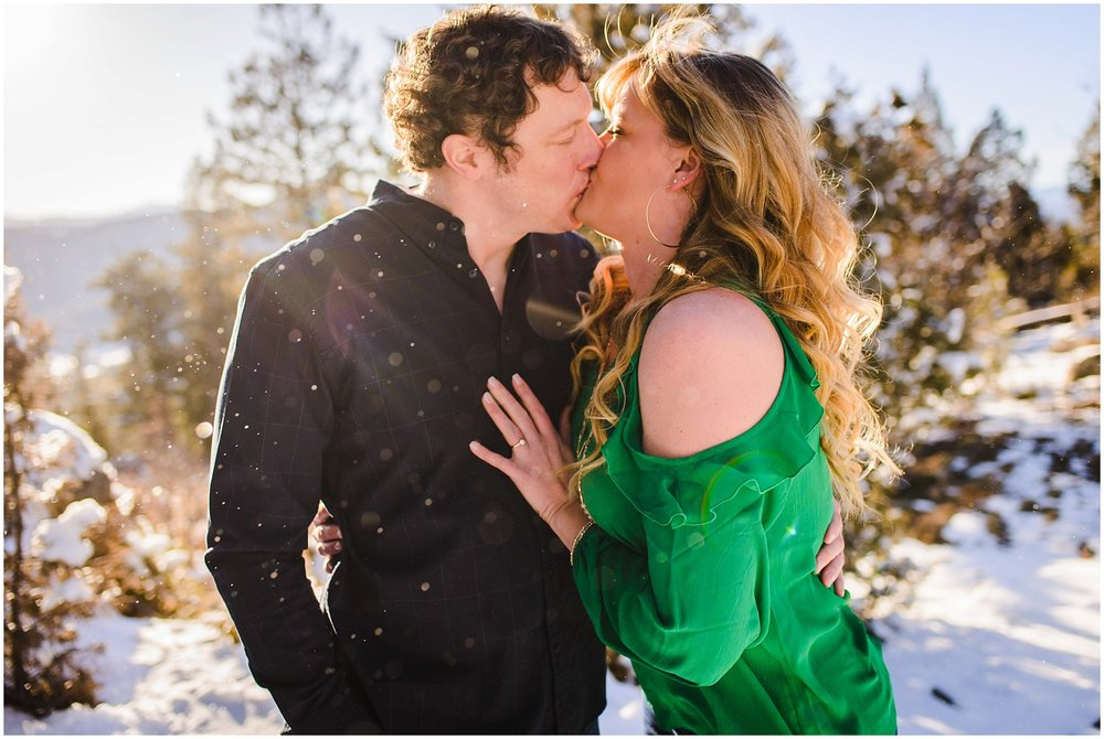 Epic Colorado mountain winter engagement photo of couple kissing in the snow