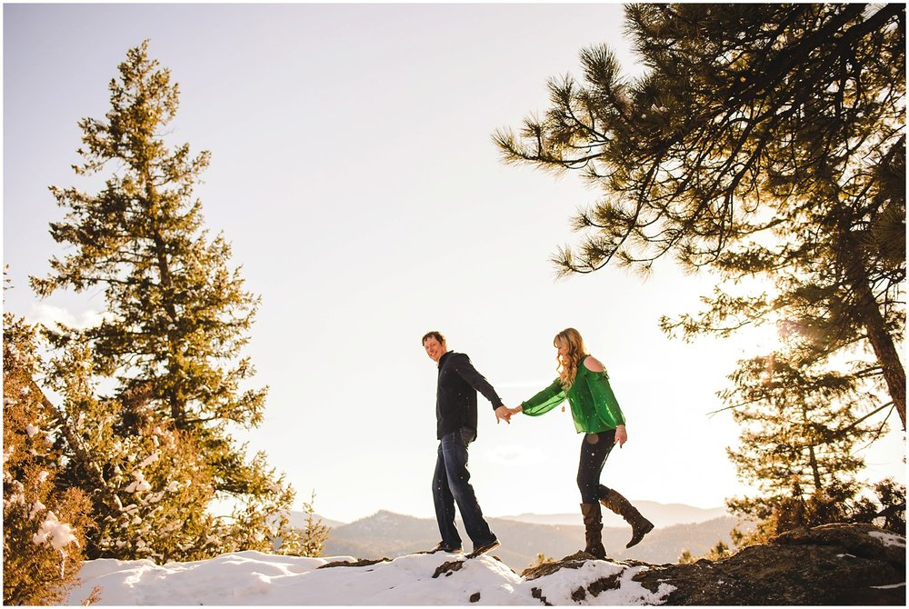 Adventurous Colorado mountain engagement photo of couple hiking at Mt. Falcon near Morrison