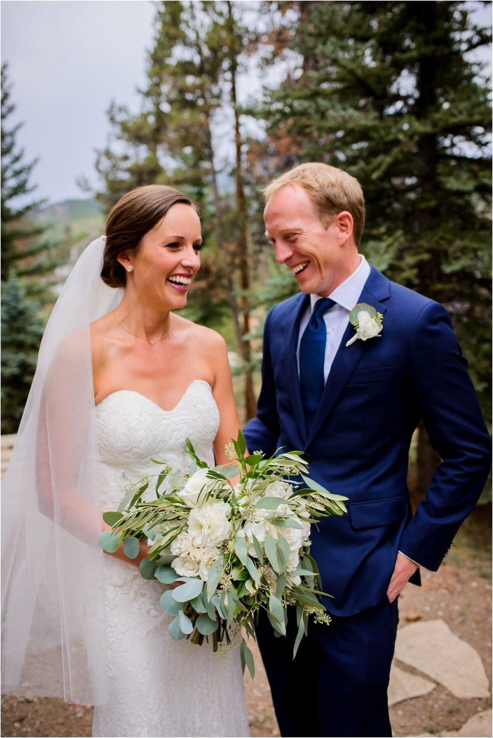 laughing bride and groom in Keystone colorado
