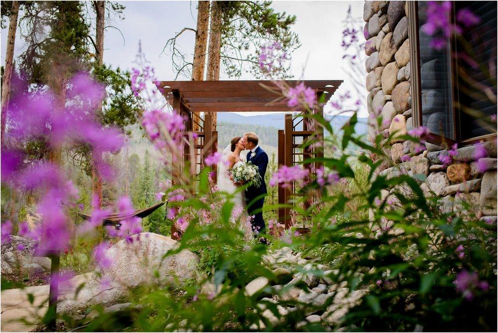 Bride and Groom kiss in purple wildflowers