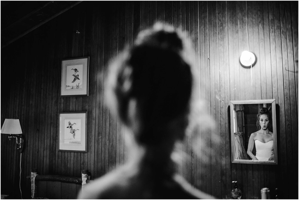 candid image of bride seeing herself in mirror