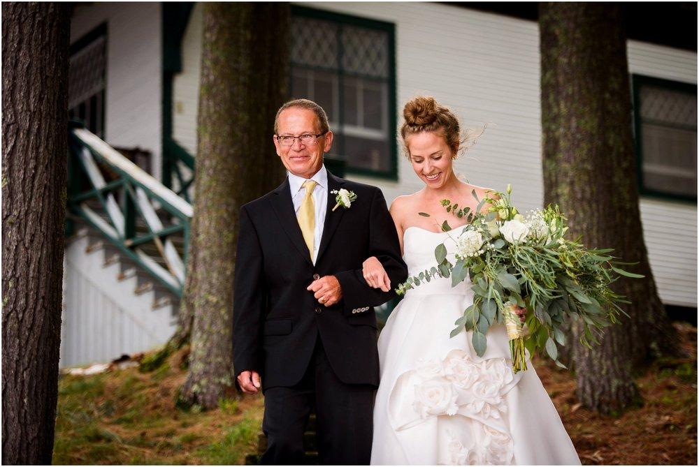 Bride walks down aisle in woods