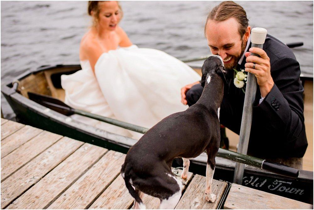 dog kissing groom on boat